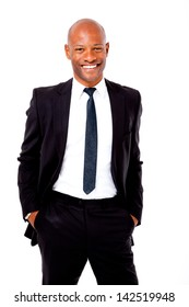 Happy African business man with his hands in his pockets shot on an isolated background