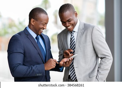 happy african businessmen using smart phone