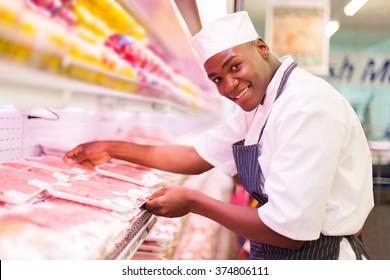 happy african butcher working in butchery