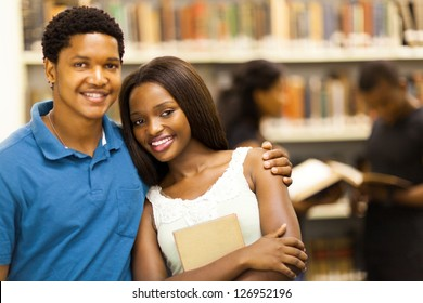 happy african college couple in library