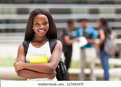 happy african college girl outdoors on modern campus
