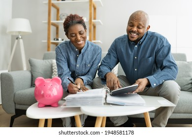 Happy African Couple Doing Retire Finances Plan And Money Budget - Shutterstock ID 1948581178