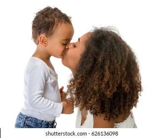 Happy African Ethiopian mother kissing her 18 month old little boy