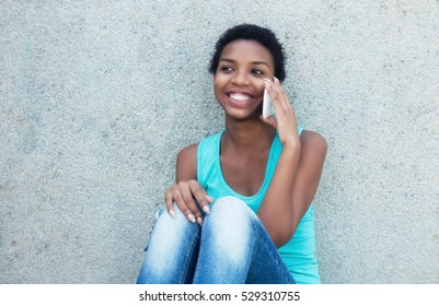 Happy african girl with cell phone