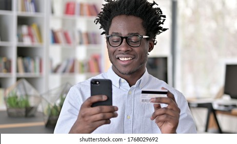 Happy African Man Shopping Online, Credit Card Payment on Smartphone