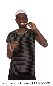 Happy African Muslim using siwak, isolated on a white background.