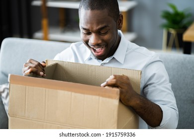 Happy African Opening Package. Receiving Parcel Gift