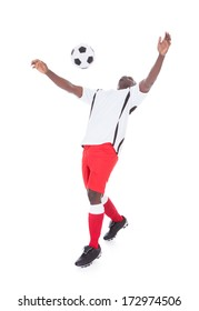 Happy African Player Playing With Soccer Ball Over White Background