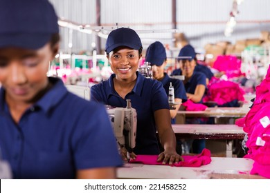 happy african textile workers on the production line