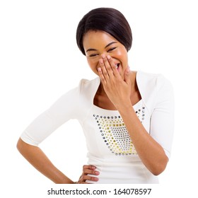 happy african woman covering her mouth and laughing isolated on white background
