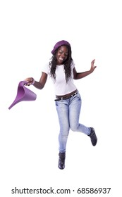 Happy african woman dancing with a watering can (isolated on white)