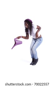 Happy african woman holding a watering can (isolated on white)