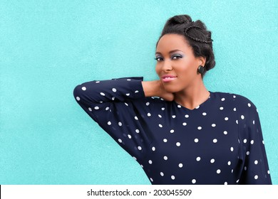 Happy African woman with makeup and hair style updo with braids and copy space