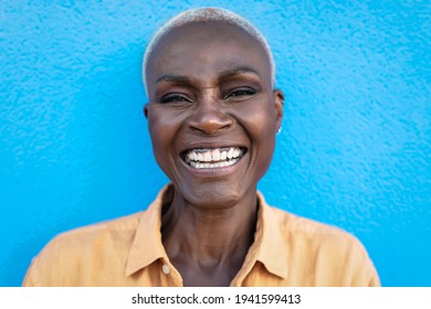 Happy African woman portrait - Afro senior female having fun smiling while posing in front of camera