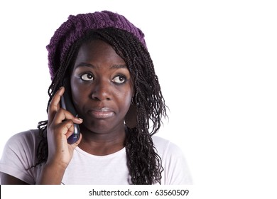 happy african woman speaking at the telephone and looking to the copy space (isolated on white)