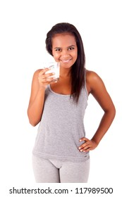 Happy african young female holding a glass of fresh milk