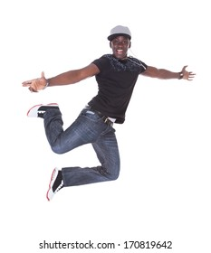Happy African Young Man Dancing Over White Background