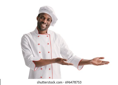 happy african-american chef doing presentation on copy space isolated on white