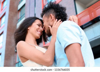 Happy African-American couple outdoors on spring day