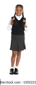 Happy African-American girl in school uniform on white background