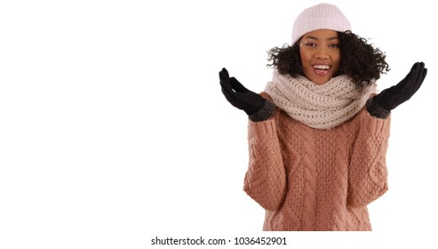 Happy African-American woman in winter attire posing on white copy space