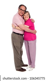 Happy aged woman hugging her husband and looking at camera