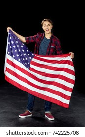 happy american boy with usa flag isolated on black