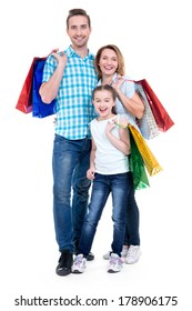 Happy american family with child holding shopping bags - over white background