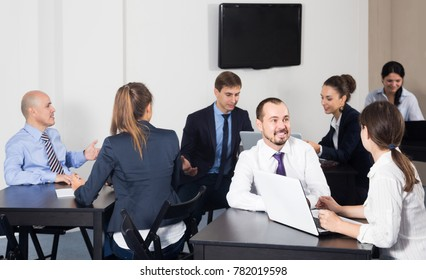 happy american people working productively on business project together in office