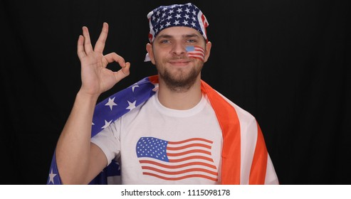 Happy American Supporter Man Showing Hand Gesture Ok Sign for Baseball Game Victory or other International Sport Event