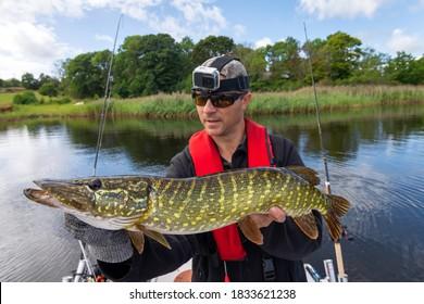 Happy angler with huge sea pike