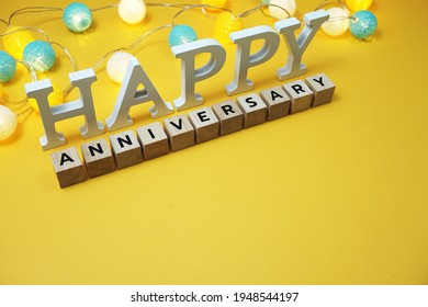 Happy Anniversary alphabet letter with LED cotton balls on yellow background