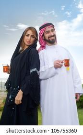 Happy Arabian couple enjoying time  & drinking tea