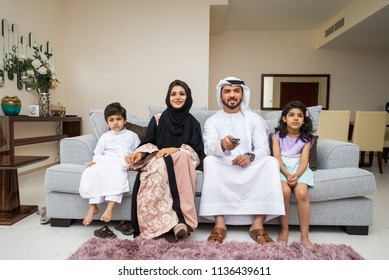 Happy arabian family having fun at home