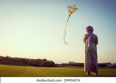 Happy Arabic kid with kite