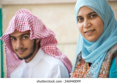 Happy Arabic young man and woman