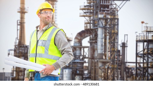 Happy architect against image of factory