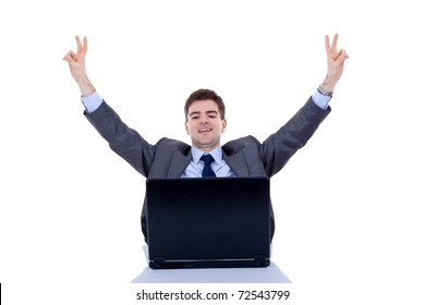 Happy arm rising winning business man, screaming at his desk