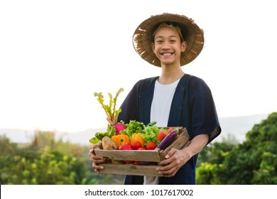 Happy Asia farmer smiling while hold various of vegetable product, Asian farmer lifestyle, Healthy eating, good food concept.