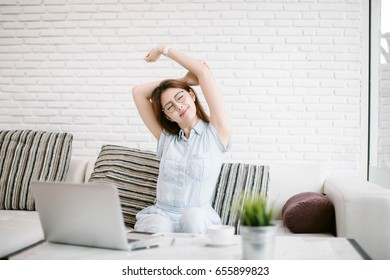 Happy Asia woman using laptop at home