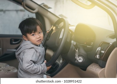 happy asian  baby 2years old drive a car