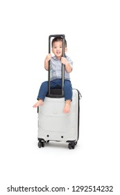 Happy Asian baby boy sitting travel bag or suitcase isolated on white background, Traveling and new adventures family trip for child passenger concept, One year six month old model