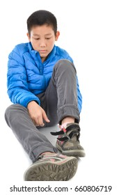 Happy Asian boy with blue down and wearing shoes isolation on the white