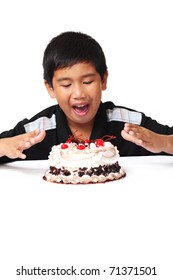 Happy asian boy with delicious cake