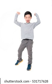 Happy Asian boy with hands up and smiling isolated over white background