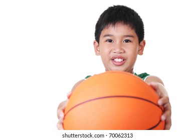 happy asian boy holding a ball
