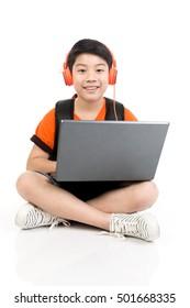 Happy asian boy using laptop on white background .