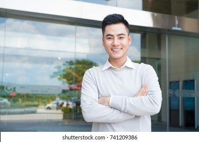 Happy asian business man portrait at the office