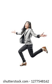 Happy asian business woman running to the finish line with open palm hand posing isolated over white background