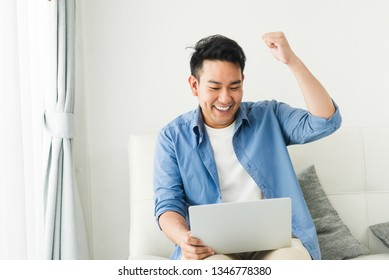 Happy Asian businessman raising his fist up when success, lifestyle concept